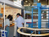 Full height turnstiles and rotor turnstile in the exhibition «Expo Seguridad Mexico-2006». Mexico City, Mexico.