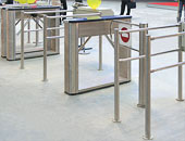 S-700 system with TTD-03.1 box tripod turnstile and WMD-05 motorized swing gate